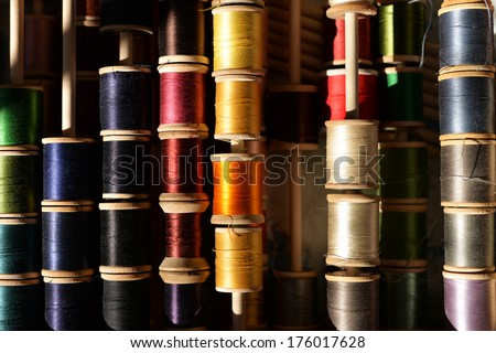 colorful spools of thread in a box - stock photo