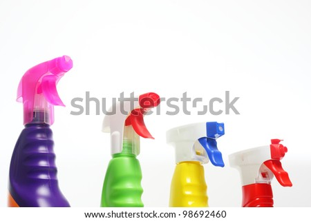 Colorful spray bottles with cleaning agents