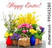 colorful spring flowers and easter eggs decoration. ranunculus, campanula, forsythia, tulip. Happy Easter! card concept - stock photo