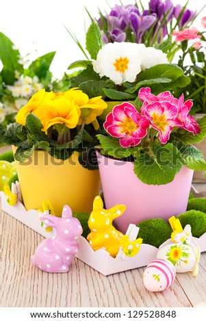 colorful spring flowers with easter decoration - stock photo