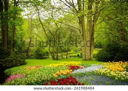 Colorful spring lawn in dutch garden 'Keukenhof', Holland, retro toned - stock photo