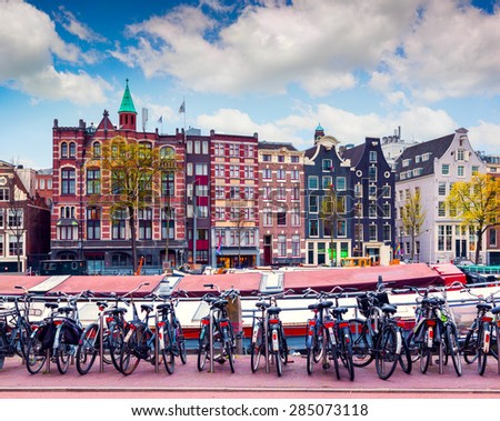 Colorful spring morning in the Amsterdam. Authentic Dutch architecture in the capital and most populous city of the Netherlands. - stock photo