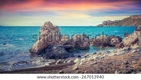 Colorful spring panorama of sunrise on the harbor and cape Milazzo with nature reserve Piscina di Venere before the storm, Sicily, Italy, Tyrrhenian sea, Europe. - stock photo
