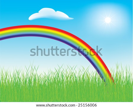 Colorful spring rainbow in a meadow with fresh green grass