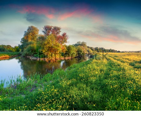 Colorful spring sunrise on the river - stock photo