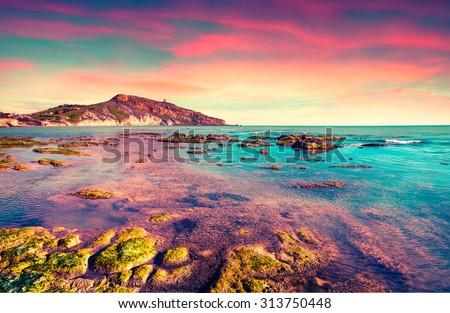Colorful spring sunset from the Giallonardo beach, Sicily, Italy, Mediterranean sea, Europe. Instagram toning. - stock photo