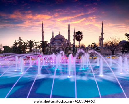 Colorful spring sunset in Sultan Ahmet park in Istanbul, Turkey, Europe. Colorful fountain on the background of the Loonic Blue Mosque. Artistic style post processed photo. - stock photo