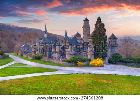 Colorful spring sunset in the Wilhelmshohe Castle, Hessen, Kassel, German, Europe. - stock photo