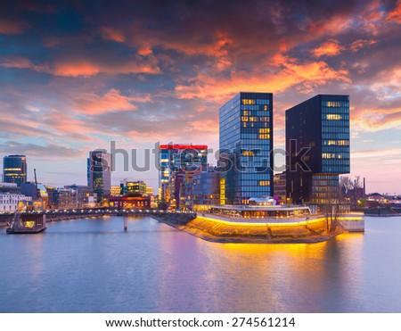 Colorful spring sunset of Rhein river at night in Dusseldorf. Medienhafen in the soft evening light, Nordrhein-Westfalen, Germany, Europe. - stock photo