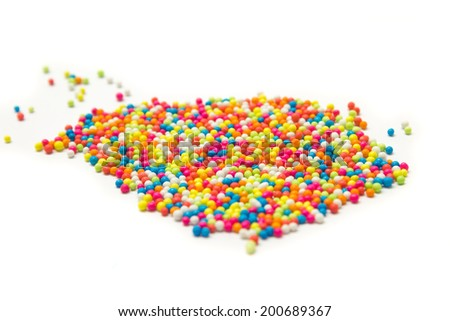 colorful sprinkles isolated on white background
