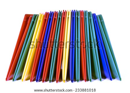 Colorful Stacked Plastic Folders Isolated On White BAckground - stock photo