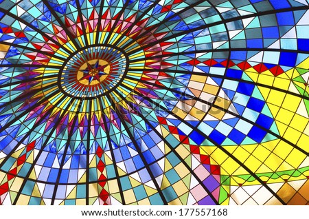 colorful stained glass ceiling in a shopping mall - stock photo