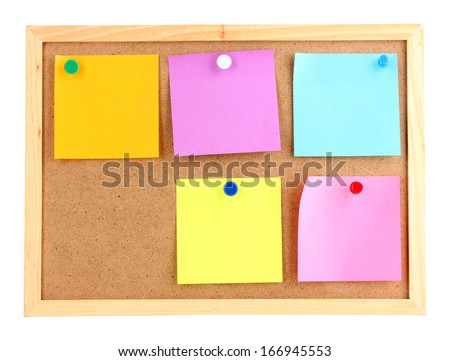 Colorful sticky notes on board isolated on white