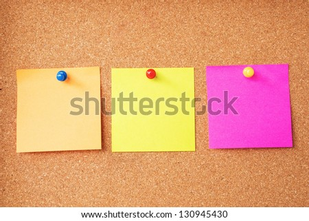 Colorful sticky notes on cork board