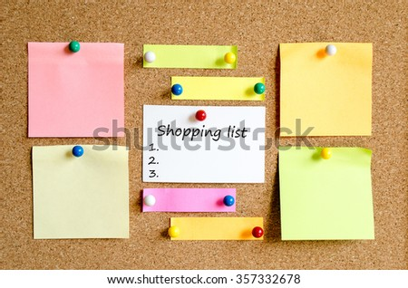Colorful sticky notes on cork board background and text concept shopping list - stock photo