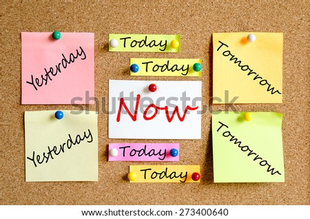 Colorful sticky notes on cork board background now concept - stock photo