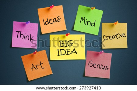 Colorful sticky notes posted on blackboard  - stock photo