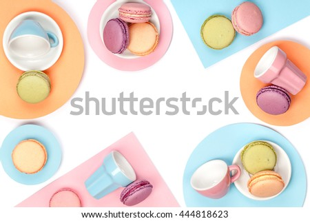 colorful still life with french dessert macaroons on white background top view. creative flat lay concept with copy space