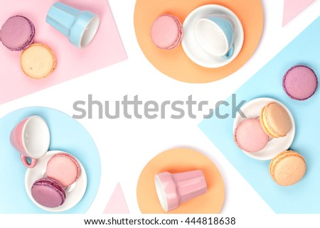colorful still life with french dessert macaroons on white background top view. creative flat lay concept with copy space - stock photo