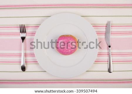 colorful stock image of doughnut on white plate. diet conceptual - stock photo