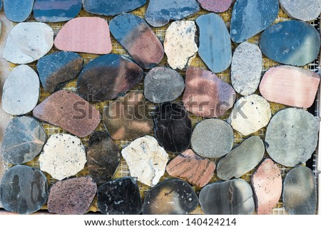 Colorful stone tiles pattern - closeup background texture - stock photo