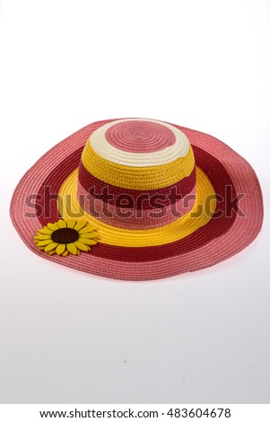 Colorful straw hat with sunflower isolated on white background.