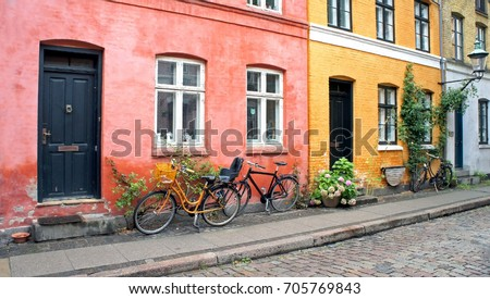 Colorful street doors windows red and yellow walls and bikes with basket in & Colorful Street Doors Windows Red Yellow Stock Photo (Royalty Free ...