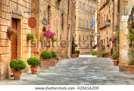 Colorful street in Pienza, Tuscany, Italy - stock photo