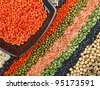 colorful striped rows of dry lentils, grain ,peas, groats , soybeans, legumes, rice, backdrop with  plate dish - stock photo