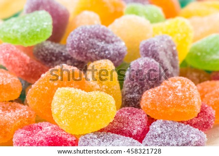 Colorful sugary candy heart shape background
