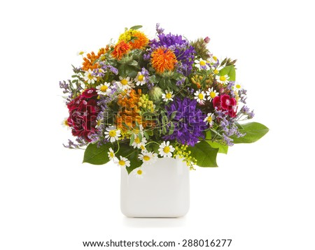 Colorful summer flower bouquet arranged in a vase isolated on white background