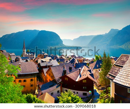 Colorful summer morning in the Hallstatt village in the Austrian Alps. Maria am Berg church and Hallstattersee lake, Austria, Europe. - stock photo