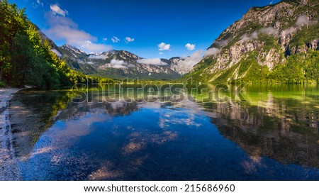 Colorful summer morning on the Bohinj lake in Triglav national park Slovenia, Alps, Europe. - stock photo