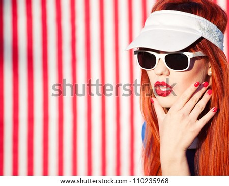 Colorful summer portrait of a woman with sunglasses - stock photo