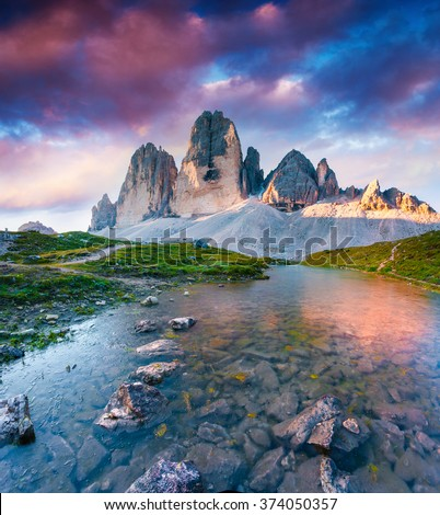 Colorful summer scene on the lake Rienza - Ursprung in National Park Tre Cime di Lavaredo. Sunrise in Dolomite, South Tyrol. Location Auronzo, Italy, Europe.