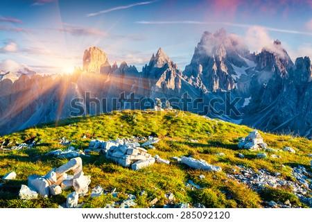 Colorful summer sunrise of the Cadini di Misurina range in National Park Tre Cime di Lavaredo. Dolomites, South Tyrol. Location Auronzo, Italy, Europe. - stock photo