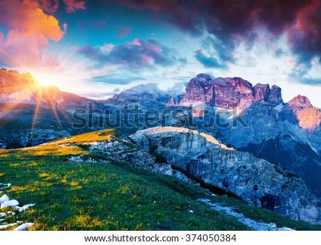 Colorful summer sunrise on Gruppo del Cimonega mountain range in National Park Tre Cime di Lavaredo. Dolomite, South Tyrol. Location Auronzo, Italy, Europe. - stock photo