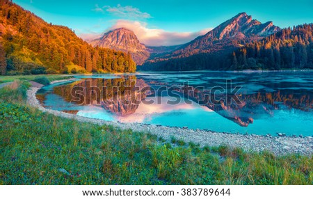Colorful summer sunrise on the incredibly beautiful Swiss lake Obersee, located near Nafels village. Alps, Switzerland, Europe. Instagram toning. - stock photo