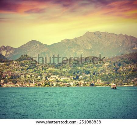 Colorful summer sunrise on the lake Como, city Dervio, Lombardy, Italy, Europa. Retro style. - stock photo