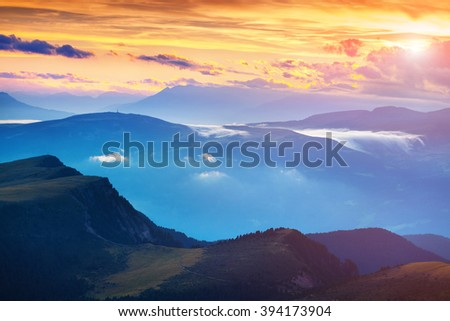 Colorful summer sunset in the Dolomite Alps. Evening view from Furchetta peak on Santa Magdalena village. Province of Bolzano, South Tyrol, Italy. - stock photo