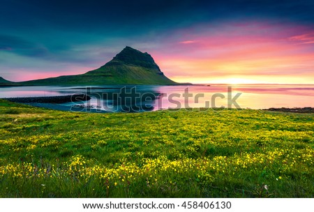 Colorful summer sunset with Kirkjufell mountain. Dramatic scene on Snaefellsnes peninsula with fall of tide in Atlantic ocean, Iceland, Europe.