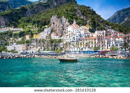 Colorful sunny Amalfi town landmark on Italy Positano coast. - stock photo
