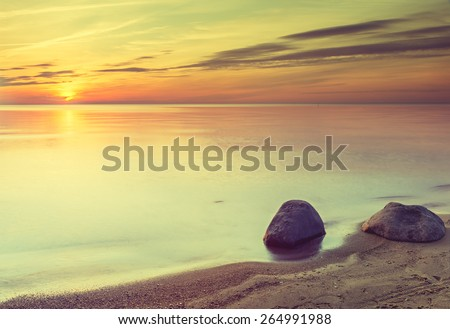 Colorful sunrise at the Baltic sea with instagram effect for inspiration of retro style - stock photo