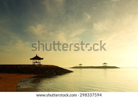 Colorful sunrise at Yoga on Sanur Beach of bali, Indonesia - stock photo