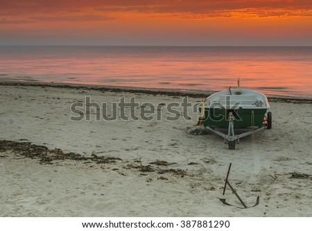 Colorful sunrise near a village of fishermen, Baltic Sea - stock photo