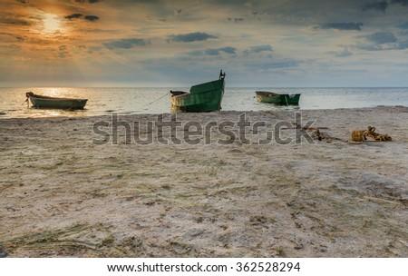 Colorful sunrise near a village of fishermen, Baltic Sea, Latvia - stock photo
