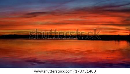 Colorful sunrise on a lake - stock photo