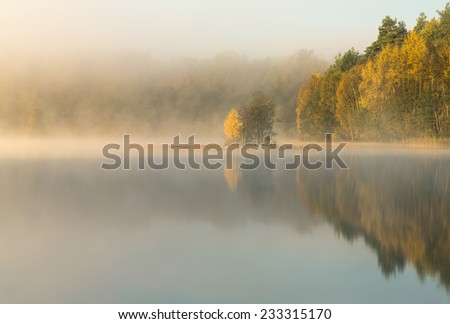 Colorful sunrise on Bobiecino lake in north Poland. Pomerania province. / Silent morning autumn reflections - stock photo