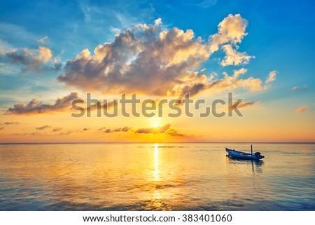 Colorful sunrise over ocean on Maldives - stock photo