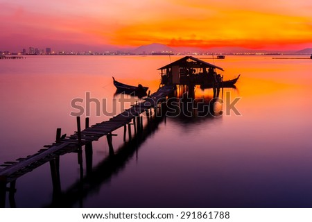colorful sunrise with traditional fisherman jetty - stock photo